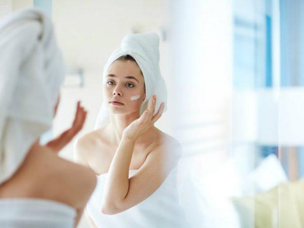 cute girl using Moisturizer skin care