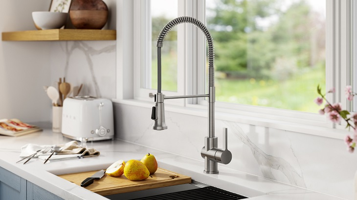 kitchen faucet with pears on board and kitchen essentials in background