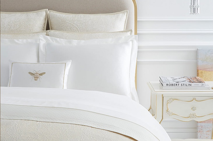 white sheets with golden details